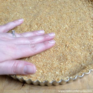 Making a graham cracker crust for a No Bake Red, White, and Blue Cheesecake Tart | Hello Little Home