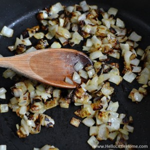 Sauteeing onions for a Savory Tomato, Feta, and Basil Pie! | Hello Little Home #NikosFeta #WaveOfFlavor #HFWF15