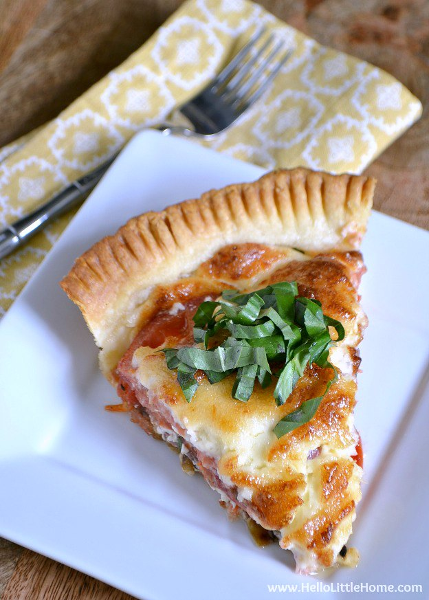 You are going to love this Savory Tomato, Basil, and Feta Pie! Get this easy recipe + over 60 more vegetarian summer recipes that are perfect for any occassion! | Hello Little Home