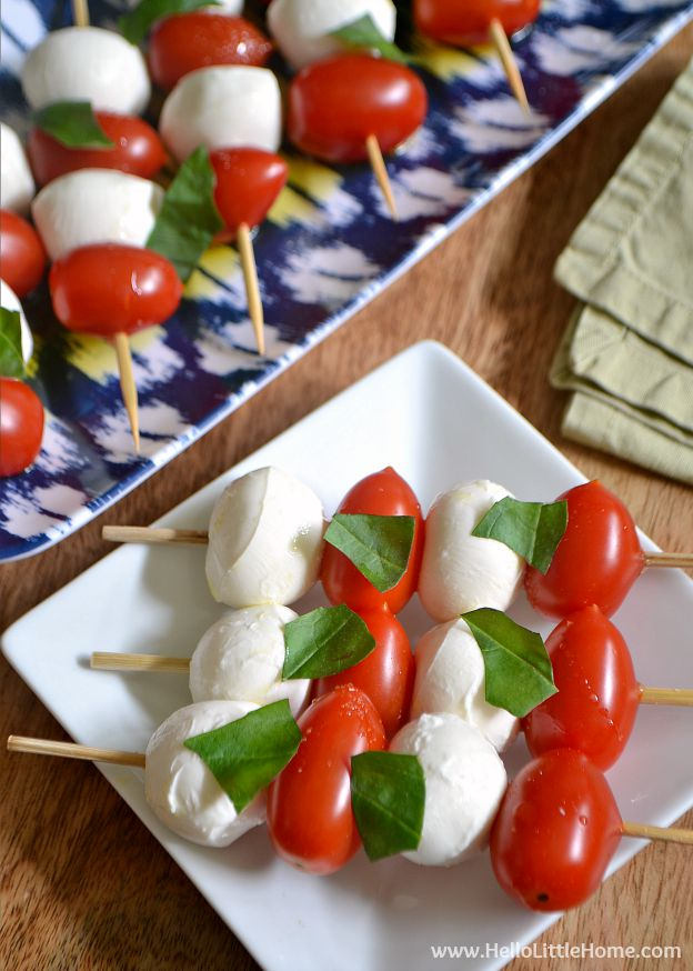 Caprese Salad Skewers ... one of 100 Vegetarian Game Day Recipes! Get ready for the big game with over 100 vegetarian and vegan appetizers, soups, chilis, main dishes, sandwiches, breakfast, desserts, and more that will make your next football watching party unforgettable! | Hello Little Home