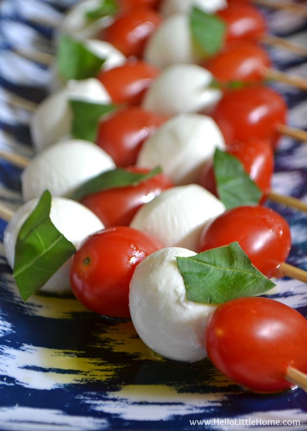 These Caprese Salad Skewers are the ultimate party appetizer! You can make these Tomato, Mozzarella, and Basil Skewers in minutes to make, and they're so easy to make ... you're going to love these Caprese Skewers! | Hello Little Home #vegetarianrecipes #appetizers #tomatomozzarellabasil #partyfood
