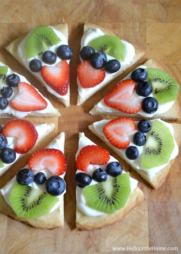 Mini Fruit Pizza Cookies topped with strawberries, blueberries, and kiwi.