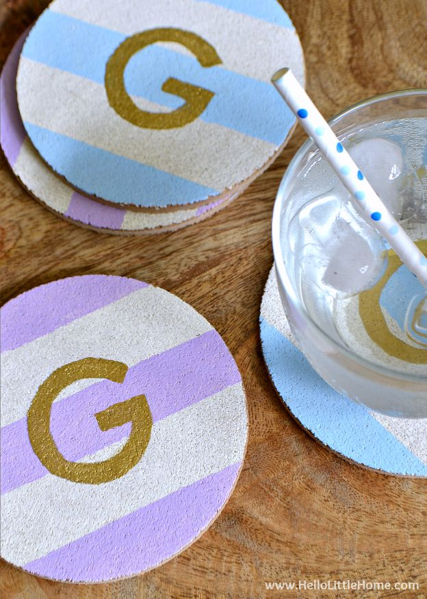 These DIY Monogram Coasters with Stripes are the perfect coffee table accessory, plus they make a great gift! | Hello Little Home