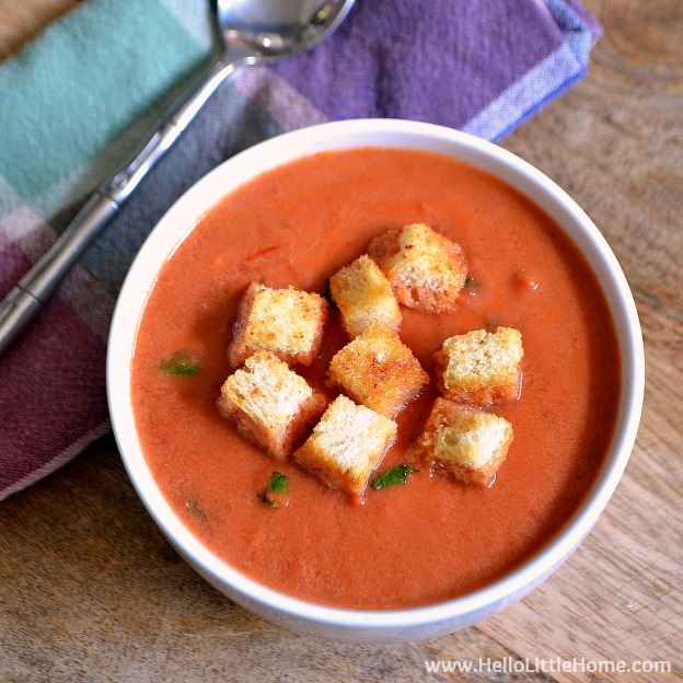Creamy Tomato Soup with Garlic Croutons ... the ultimate fall comfort food! Your whole family will love this easy vegetarian soup recipe ... make it tonight! | Hello Little Home