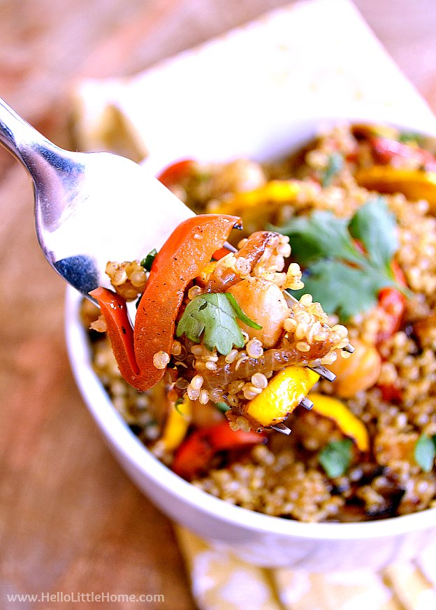 Close up of Curried Veggie, Chickpea, and Quinoa Stir Fry on a fork. | Hello Little Home