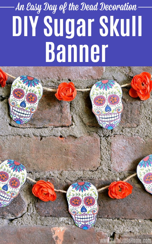 A DIY Sugar Skull Banner (with free printable) hanging on a brick wall.
