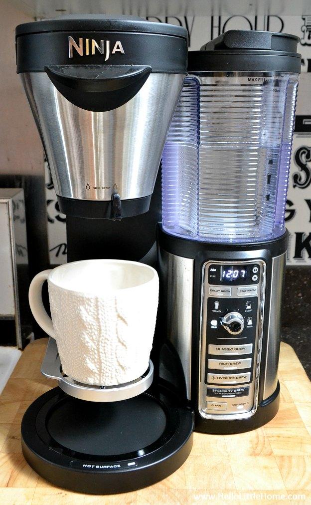 Preparing a mug of coffee with the Ninja Coffee Bar.
