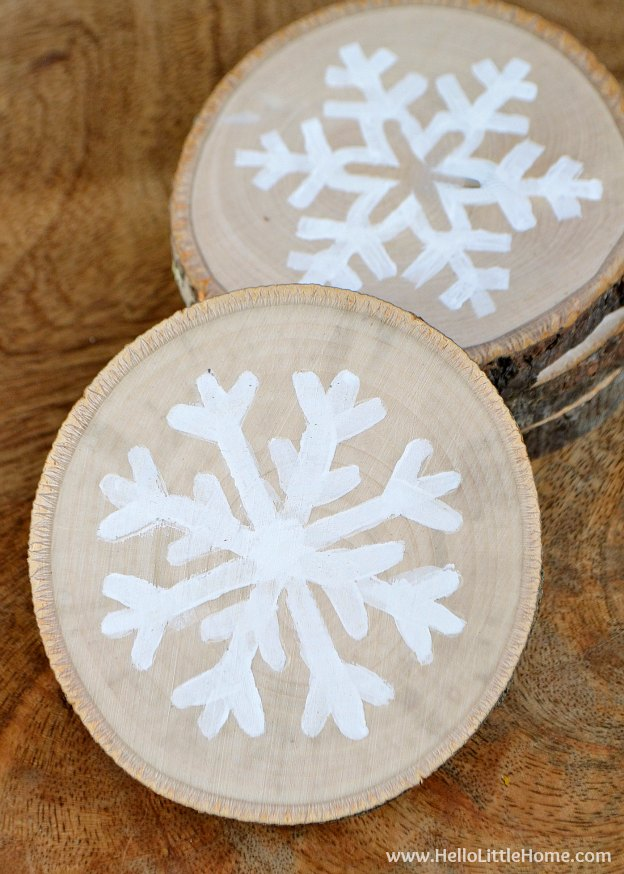 These DIY Wood Slice Snowflake Coasters make a great gift! Plus, check out our Home Gift Guide! | Hello Little Home