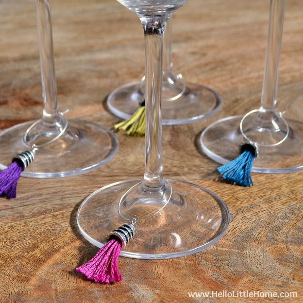 Make these DIY Tassel Wine Charms for your favorite oenophile! Plus, check out our Mens and Womens Gift Guides! | Hello Little Home