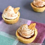 Three Mini Pumpkin Pie Bites on a Napkin