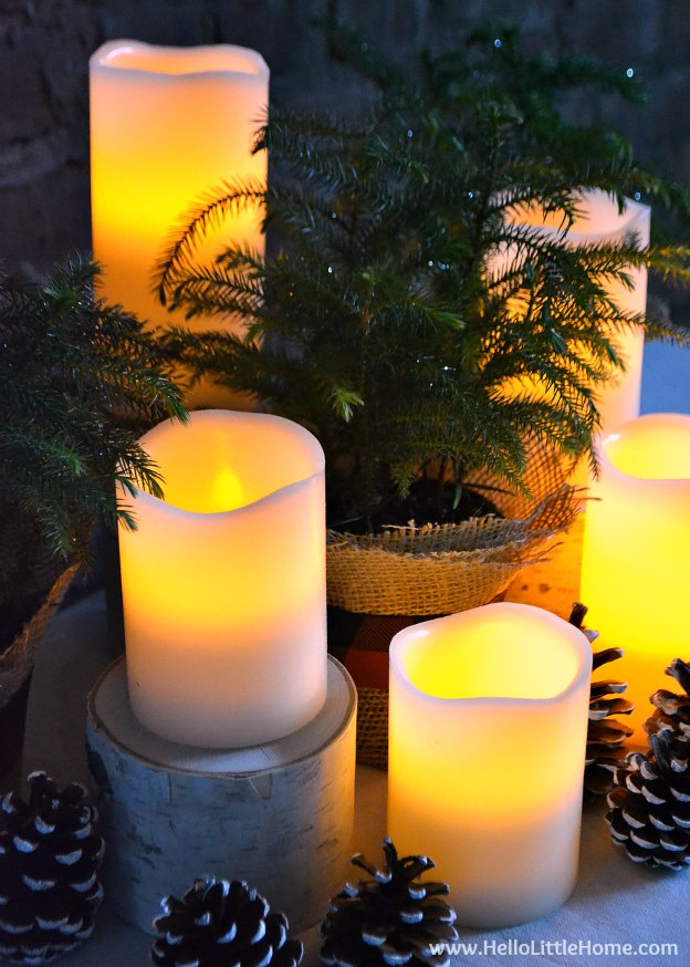 Beautiful Holiday Centerpiece on a Table with Candles Lit