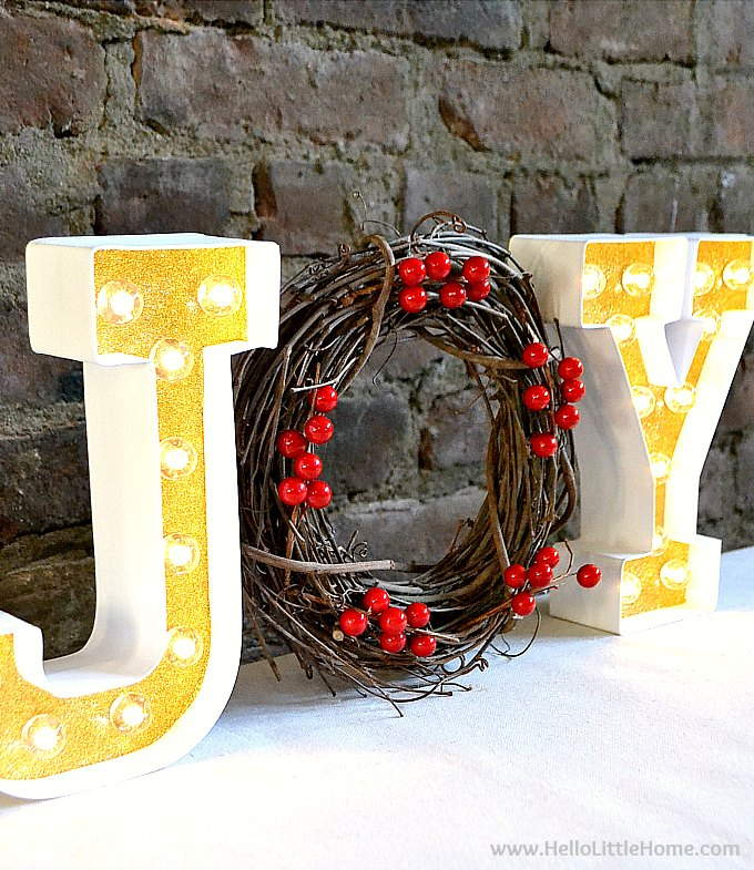 DIY Christmas Marquee Sign … learn how to make a DIY Christmas Sign with lights! This easy homemade JOY sign is a festive holiday decor idea. Just follow this simple tutorial to make your own fun lighted holiday sign with letters and a wreath. This easy Christmas craft idea is a creative way to decorate for Xmas! | Hello Little Home