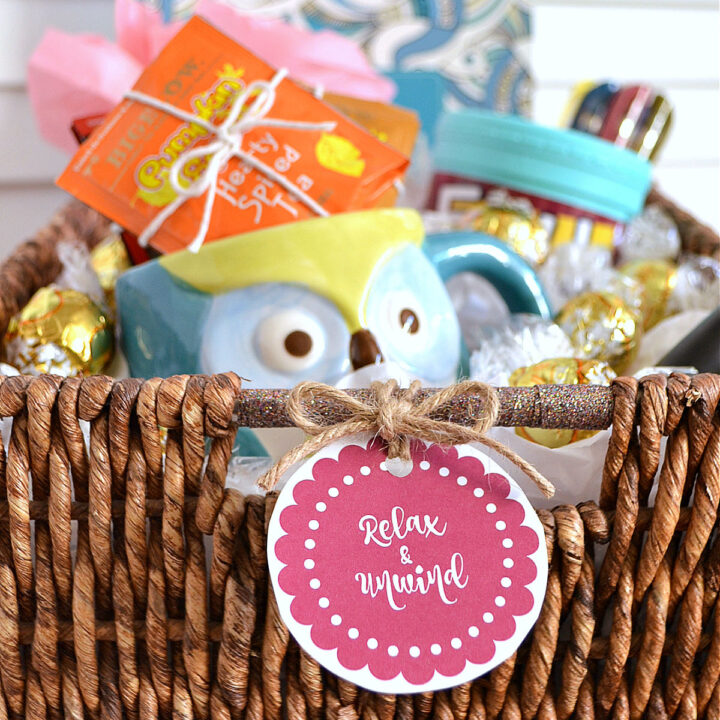 A basket filled with gifts with a decorative label on the front.
