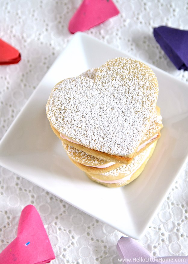 Heart Sandwich Cookies with White Chocolate Cream Cheese Filling ... the perfect Valentine's Day recipe! Learn how to make this adorable heart shaped dessert with a fun and easy recipe! | Hello Little Home