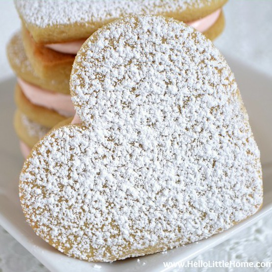 These Heart Sandwich Cookies with White Chocolate Cream Cheese Filling are the perfect Valentine's Day treat! | Hello Little Home