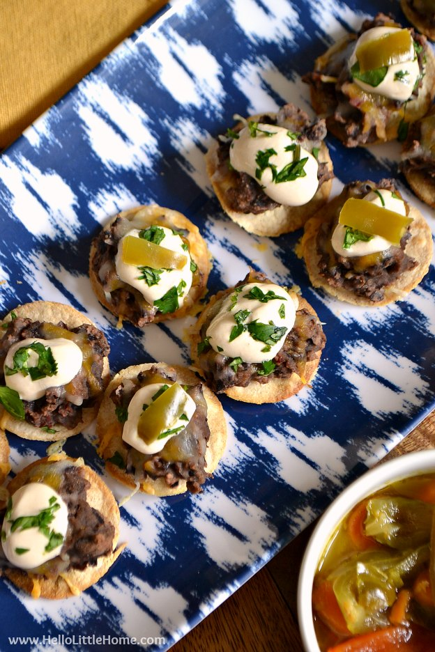 These Mini Black Bean Tostadas with Chipotle Cream are the perfect appetizer for game day or any party! Serve these easy to make vegetarian tostadas with your favorite toppings. It's a creative appetizer recipe your guests will love!   Hello Little Home #gameday #tostadas #blackbeans #mexicanfood #texmex #vegetarianrecipe