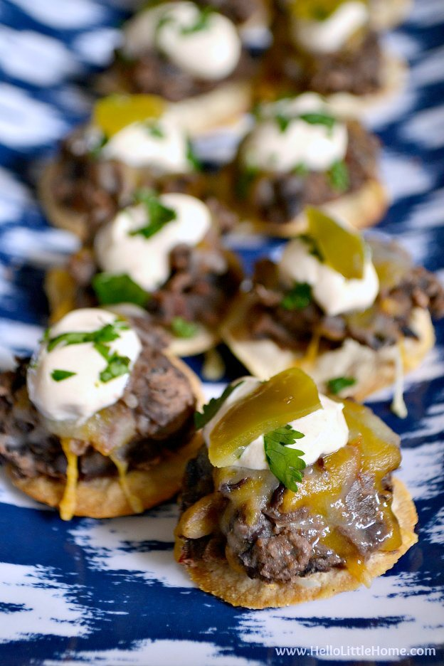 These Mini Black Bean Tostadas with Chipotle Cream are the perfect appetizer for game day or any party! | Hello Little Home