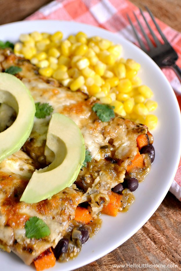 Feed a crowd with these decadent and delicious Black Bean and Butternut Squash Enchiladas with Green Sauce! | Hello Little Home