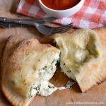 Four-Cheese and Spinach Calzones