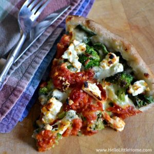 Homemade Deep Dish Pizza with Broccoli, Spinach, and Feta