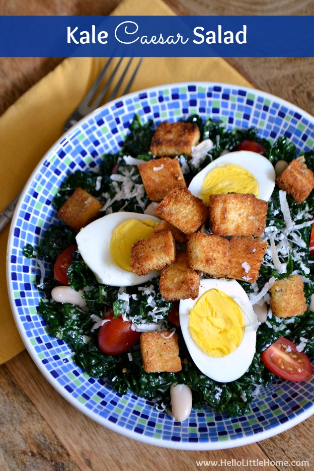 This Kale Caesar Salad is a delicious twist on a classic Caesar salad! Your whole family will love this tasty Vegetarian Caesar Salad with its crunchy homemade croutons and vegetarian Caesar Salad Dressing. This unique Kale Salad recipe make a wonderful dinner or lunch! | Hello Little Home #caesarsalad #kalesalad #kalecaesarsalad #kale #saladrecipe #vegetarian #vegetarianrecipes