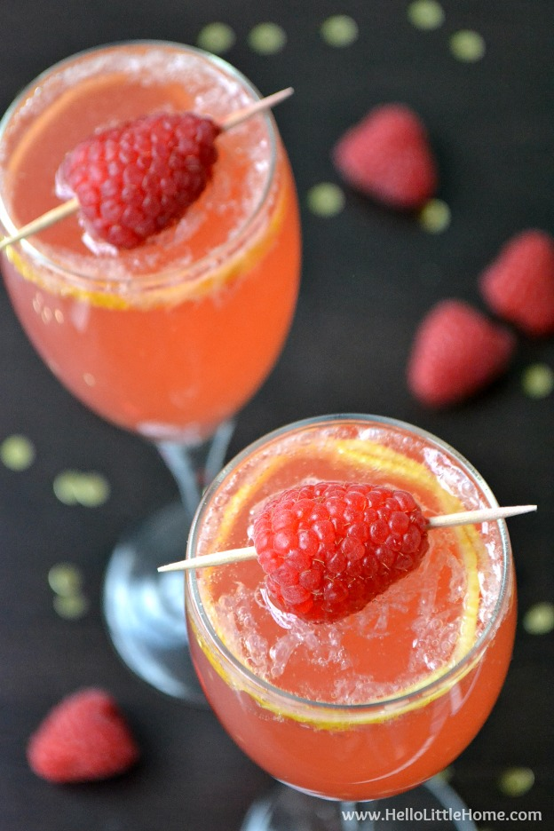 You are going to love this Raspberry French 75! Get this easy recipe + over 60 more vegetarian summer recipes that are perfect for any occassion! | Hello Little Home