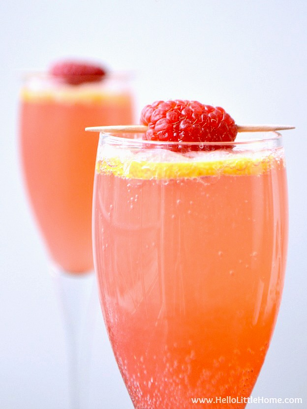 A French 75 variation topped with fresh raspberries.