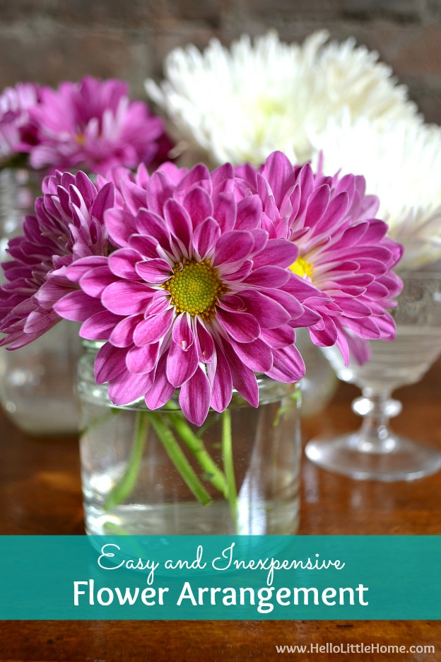 Brighten up your home with an easy and inexpensive flower arrangement! Treat yourself to a bouquet of flowers from your supermarket, then use a collection of glass jars to create this simple and stunning floral display! | Hello Little Home