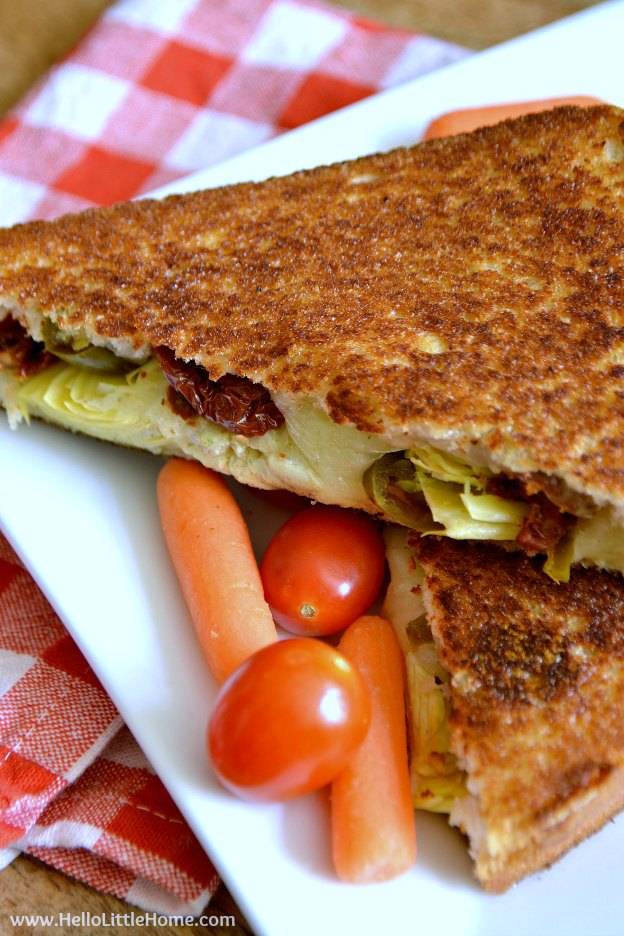Love grilled cheese? This Spicy Artichoke and Sundried Tomato Grilled Cheese Sandwich is sure to become a favorite recipe ... it's comfort food at it's best!   Hello Little Home