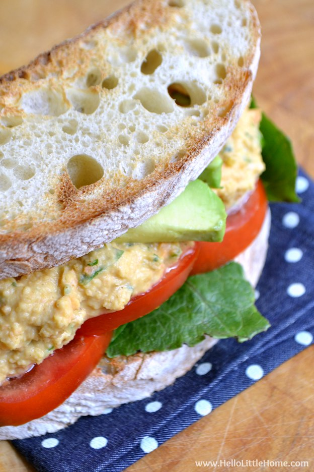 Spicy Chickpea Salad Sandwhich ... this yummy vegetarian sandwich spread is made with garbanzo beans and spiced up with sriracha, curry powder, and cilantro! Makes a great meal or serve it with crackers and veggies for a delicious snack! | Hello Little Home