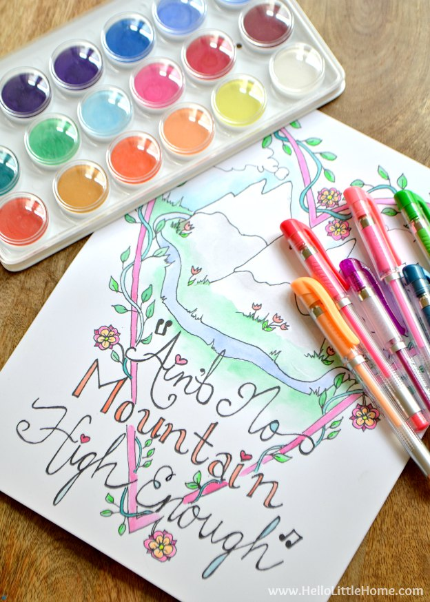 A coloring page with watercolors and markers on the side.