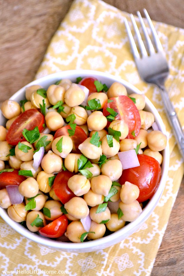 Lemony Chickpea Salad recipe ... a quick, easy vegan side dish that's a wonderful addition to any meal! This simple chickpea salad is bursting with fresh, healthy flavors! Perfect for all your summer BBQs and picnics, and makes a great light meal, too! | Hello Little Home