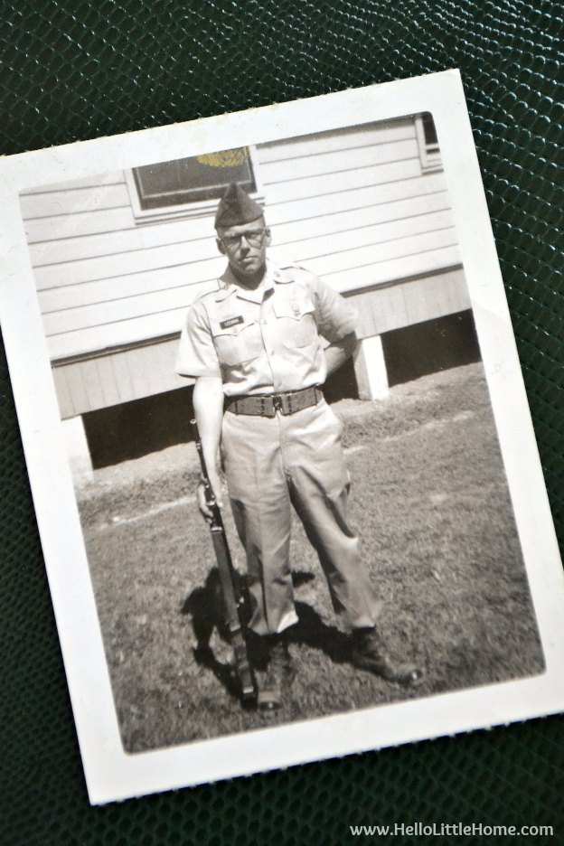 My dad in his army uniform in front of barracks.