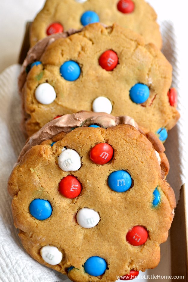 Treat yourself to these oversized Peanut Butter Chocolate Ice Cream Sandwiches! This red, white, and blue dessert is the perfect treat for any patriotic occasion like the 4th of July! This easy ice cream sandwich recipe is sure to be a hit with your family this summer! | Hello Little Home