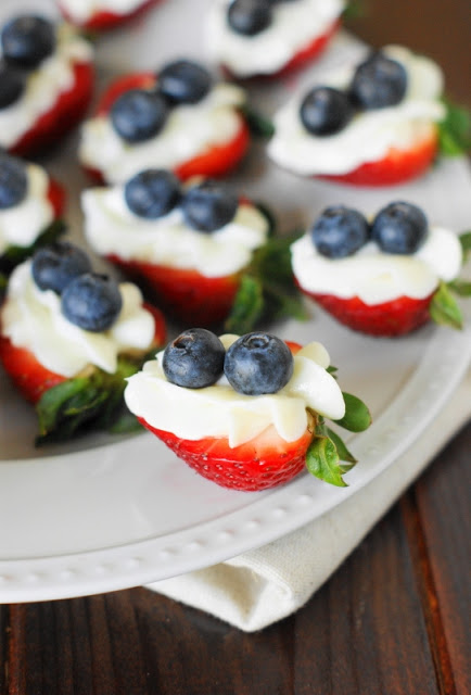 Over 30 Patriotic Recipes, Crafts, and Home Decor Ideas, including these Red, White, and Blue Strawberry Cheesecake Bites from The Kitchen Is My Playground! These fun and easy red, white, and blue ideas are perfect for celebrating every patriotic summer occassion ... 4th of July, Memorial Day, and more!   Hello Little Home