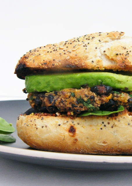 Cajun Spiced Black Bean and Sweet Potato Burgers from Tinned Tomatoes ... one of 20 Mouthwatering Veggie Burger Recipes ... perfect for all your summer cookouts and parties! These delicious vegetarian and vegan burgers are filled with healthy ingredients + super delicious ... make one for your next BBQ!   Hello Little Home