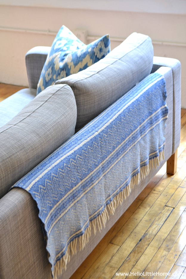 Easy Decorating Tip: All About Layering! Learn how to add interest to your home by layering textiles, decorative objects, and art! | Hello Little Home