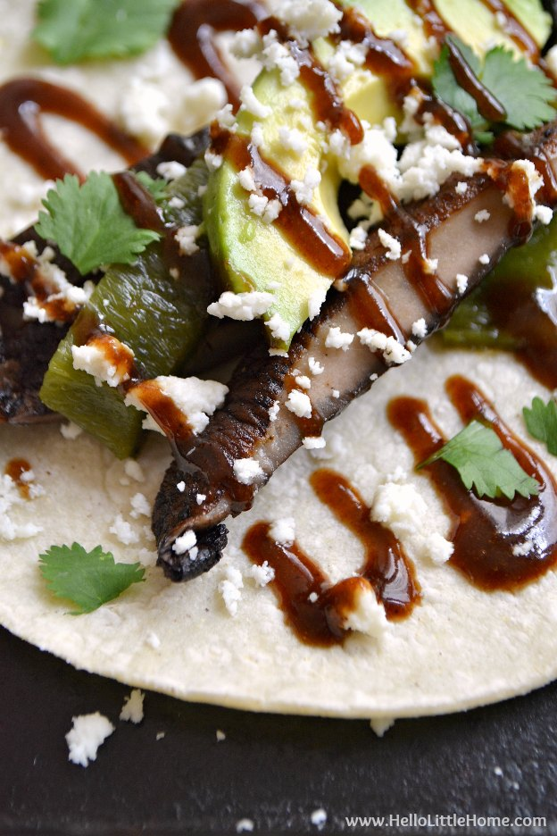 Fire up the grill! These Grilled Portabella Poblano Tacos with Sweet and Spicy BBQ Sauce are perfect for fun and laid back summer entertaining! An easy vegetarian taco recipe, filled with tasty grilled portabella mushrooms, flavorful poblano pepper, and an amazing asian-inspired barbecue sauce that's super easy to make! | Hello Little Home