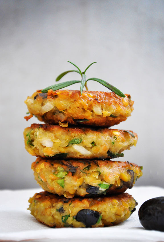 Lentil Patties with Olives and Herbs from Gourmandelle ... one of 20 Mouthwatering Veggie Burger Recipes ... perfect for all your summer cookouts and parties! These delicious vegetarian and vegan burgers are filled with healthy ingredients + super delicious ... make one for your next BBQ! | Hello Little Home