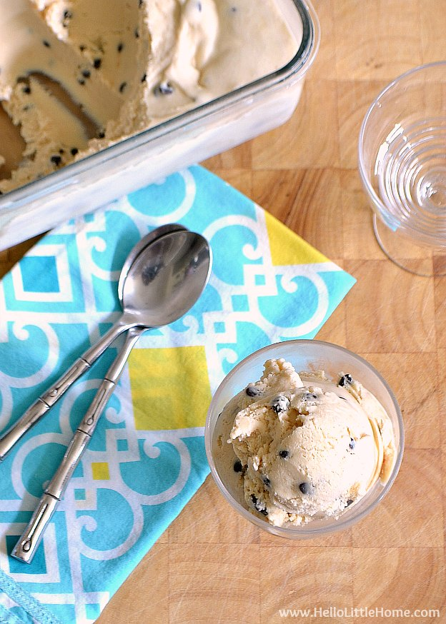 Overhead photo of a container of the finished recipe next to a scoop of froyo.