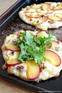 Easy step-by-step instructions for making an amazing Fresh Plum, Walnut, and Gouda Pizza, a delicious vegetarian pizza recipe that's perfect for entertaining! Pair it with your favorite wine! | Hello Little Home