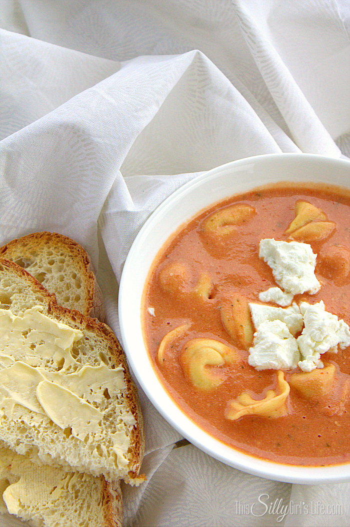 40+ Hearty Vegetarian Soup Recipes, including this Slow Cooker Tomato Soup with Tortellini and Goat Cheese from This Silly Girl's Life, that will warm you up this fall and winter! | Hello Little Home