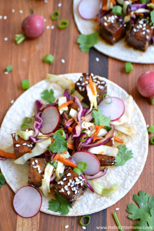 Tacos topped with Korean tofu, veggies, and cilantro.