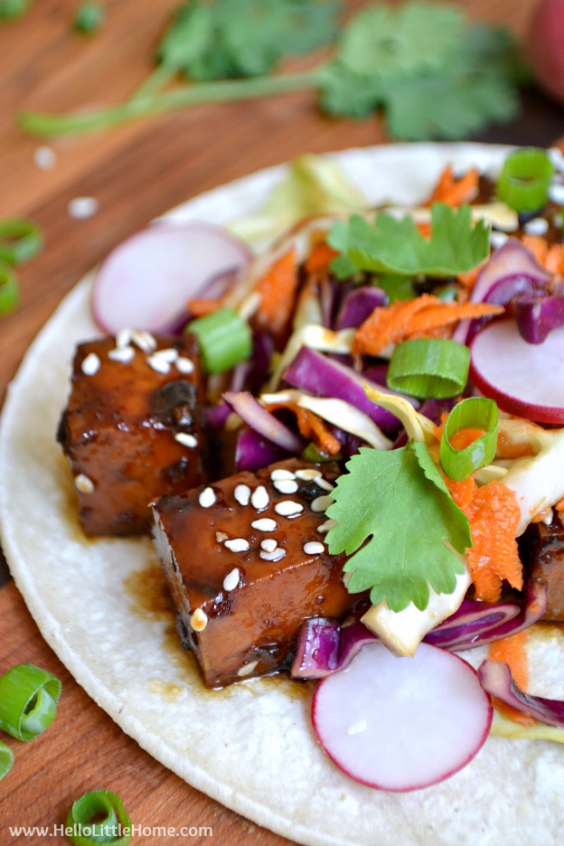 Treat yourself to this sweet and spicy Korean BBQ Tofu Tacos recipe! The flavors in these vegan tofu tacos are out of this world + they're super easy to make! | Hello Little Home