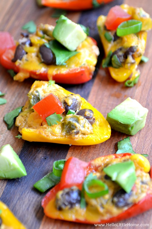 Dig in to these cheesy, delicious Mini Bell Pepper Nachos! This easy vegetarian appetizer recipe is full of flavor and packed with fresh veggies, and it's perfect for serving on game day or any party! | Hello Little Home