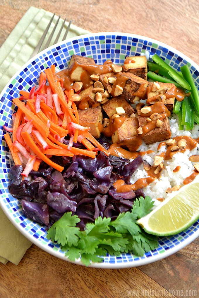 A Banh Mi Bowl with Vietnames Peanut Sauce, tofu, cabbage, pickled veggies, cilantro, and lime.