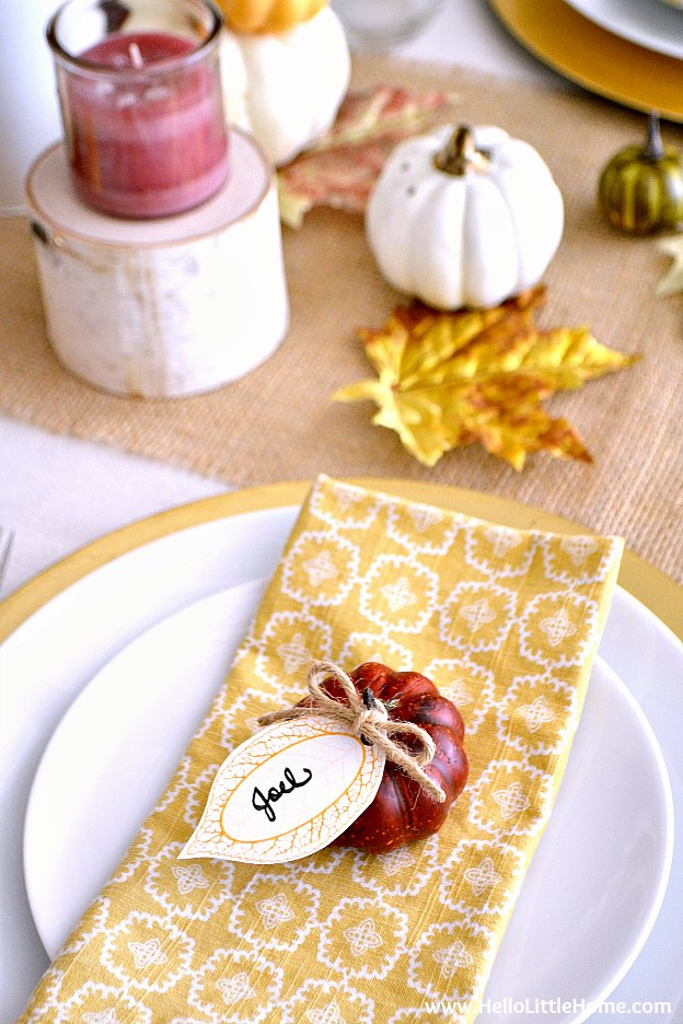 Place setting with leaf name card in the fall inspired tablescape.