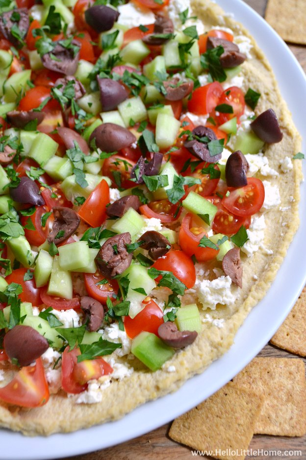 Layered Greek Hummus Dip ... an easy, delicious appetizer recipe that's perfect for your next game day party!   Hello Little Home