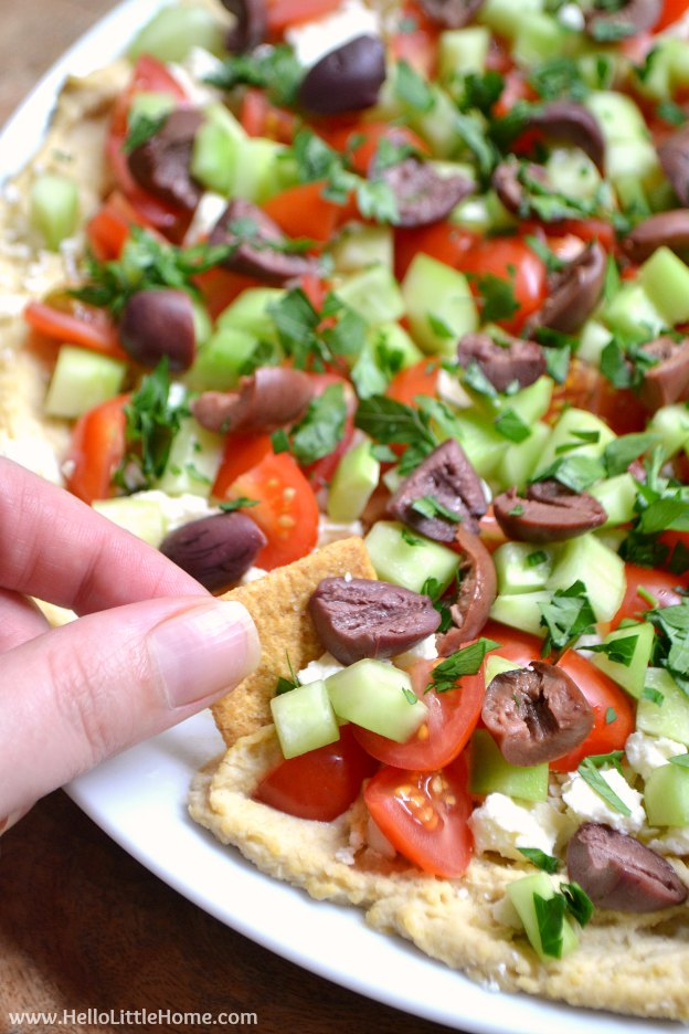 Layered Greek Hummus Dip ... one of 100 Vegetarian Game Day Recipes! Get ready for the big game with over 100 vegetarian and vegan appetizers, soups, chilis, main dishes, sandwiches, breakfast, desserts, and more that will make your next football watching party unforgettable! | Hello Little Home
