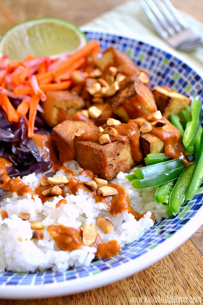 A Vietnamese Rice Bowl topped with tofu, pickled vegetables, cabbage, and peanut sauce.